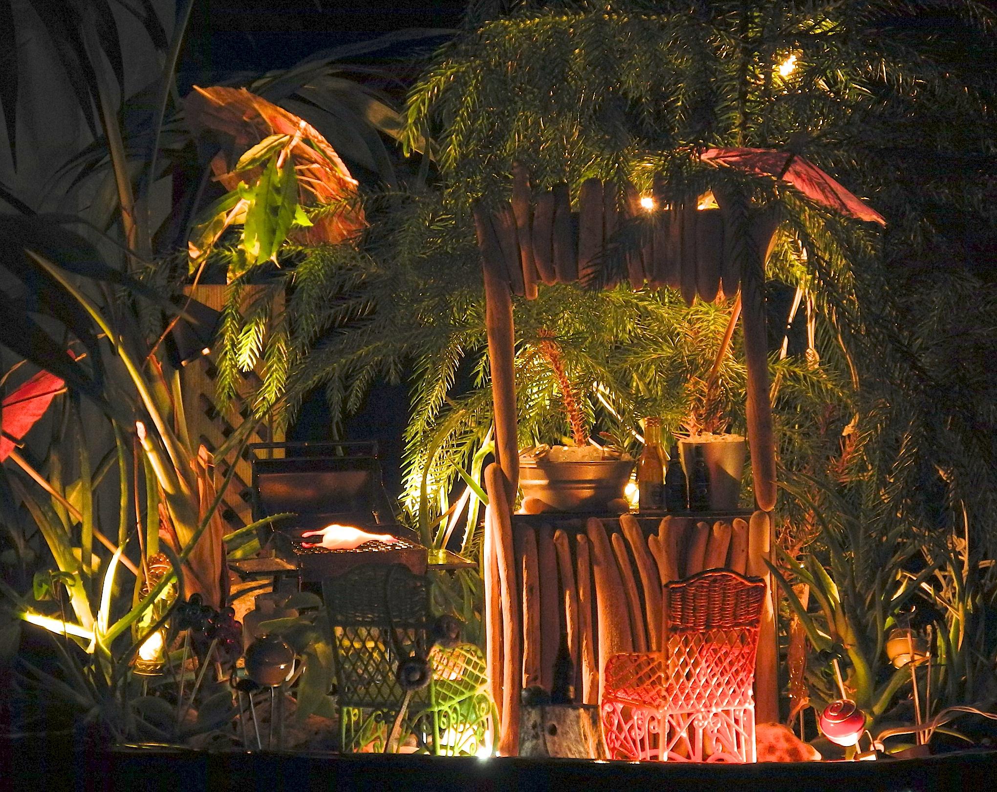 Miniature Tiki party at night.